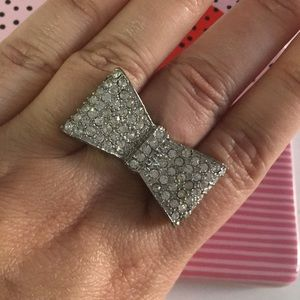 Silver bow cocktail ring with rhinestones.